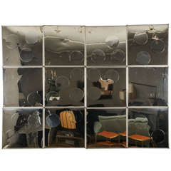 A Highly Decorative Set of 12 Metal Polished Steel Wall Elements
