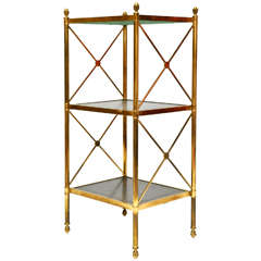 A Handsome Gilt-Brass and Bronze Etagere with Green Leather Inset Tops