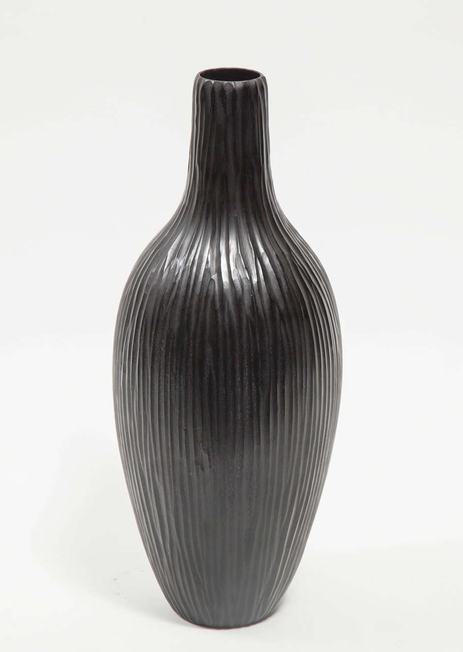 Contemporary Italian artist Massimo Micheluzzi's hand blown and battuto cut black Murano glass vase was made in 2002. Incised signature to underside: [Massimo Micheluzzi, Murano, 2002].  Image 6: Massimo Micheluzzi (Italian, born 1957)  Artist's
