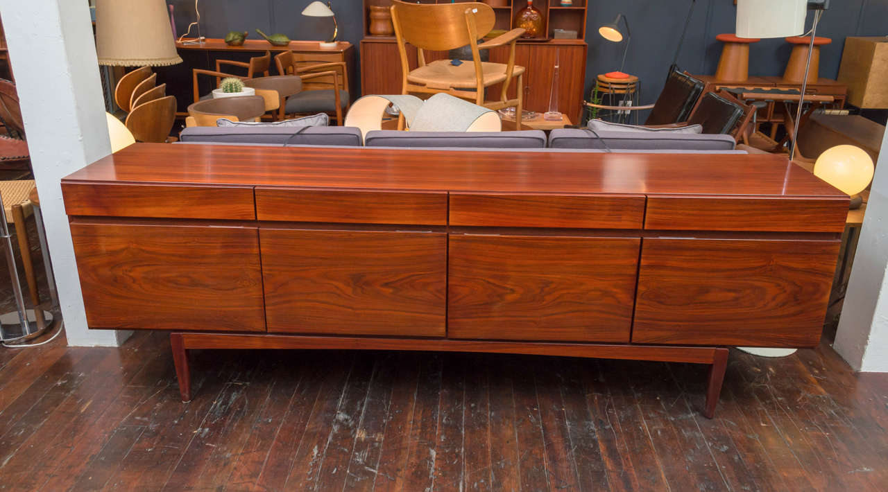 Sunning rosewood credenza designed by Ib Kofod-Larsen, comprising four top drawers over four doors with fitted interiors. Excellent original condition.