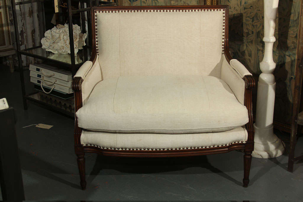 Wood frame reupholstered in linen with down cushion and nailhead trim.