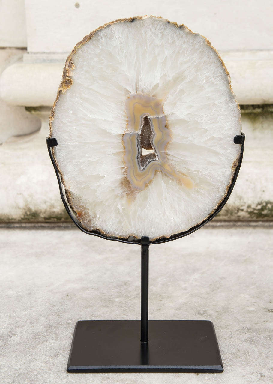 Two Agate Geode Slices Mounted On Forged Iron Stands At