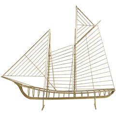 A Curtis Jere Brass Sailboat Sculpture