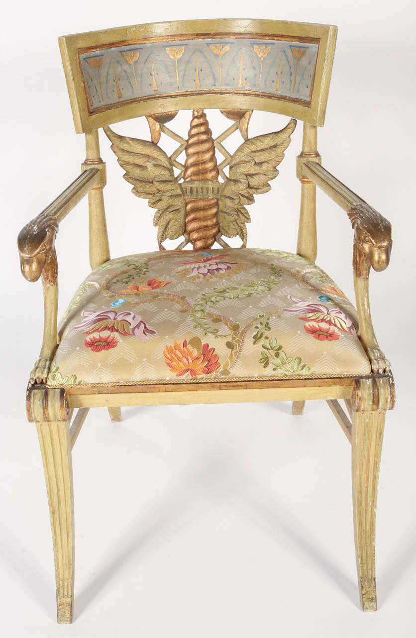 A spectacular painted and parcel-gilt fauteuil from the collection of James Perkins at Aynhoe Park. Leaf-decorated toprail and a drop-in seat of channelled sabre legs. The seat has been newly upholstered in silk Lampas fabric by Prelle, France.