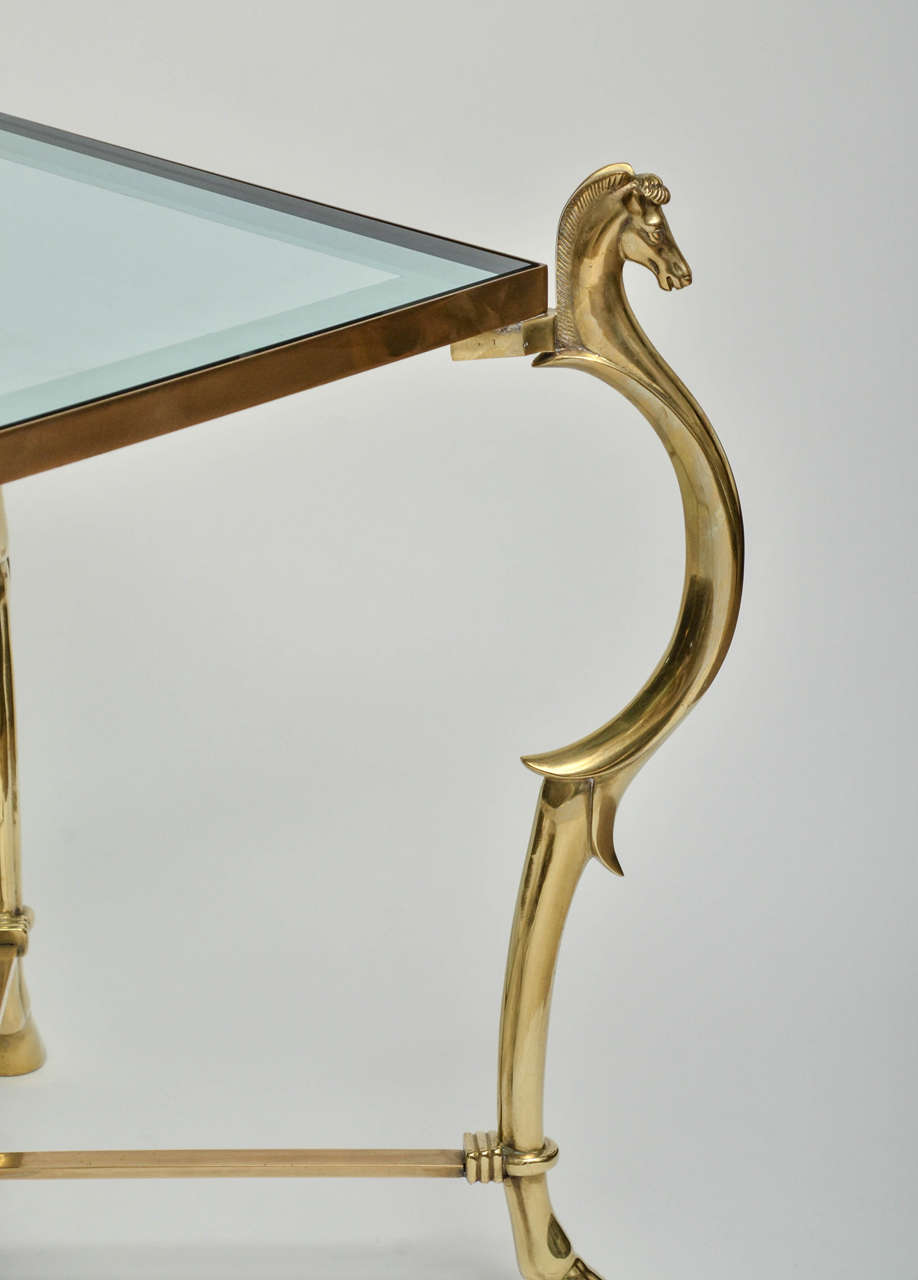 Mid-Century Modern Pair of Curvilinear Brass Side Tables with Horse Head Finials For Sale