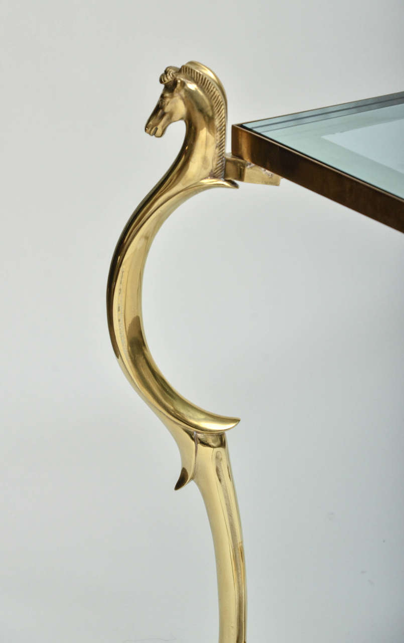 Italian Pair of Curvilinear Brass Side Tables with Horse Head Finials For Sale