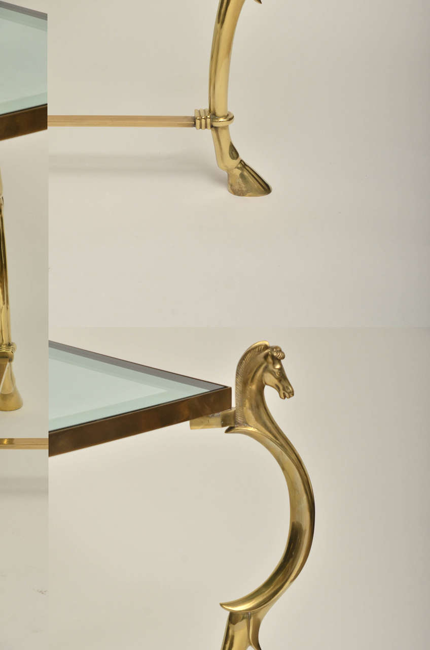 20th Century Pair of Curvilinear Brass Side Tables with Horse Head Finials For Sale