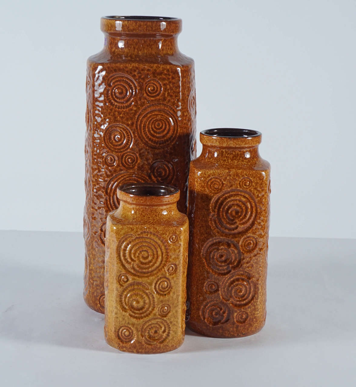 A trio of amber glazed mcm west german pottery vases at 1stdibs west german pottery vases for sale rich high gloss amber colored glaze over a curlicue bas relief pattern mint reviewsmspy