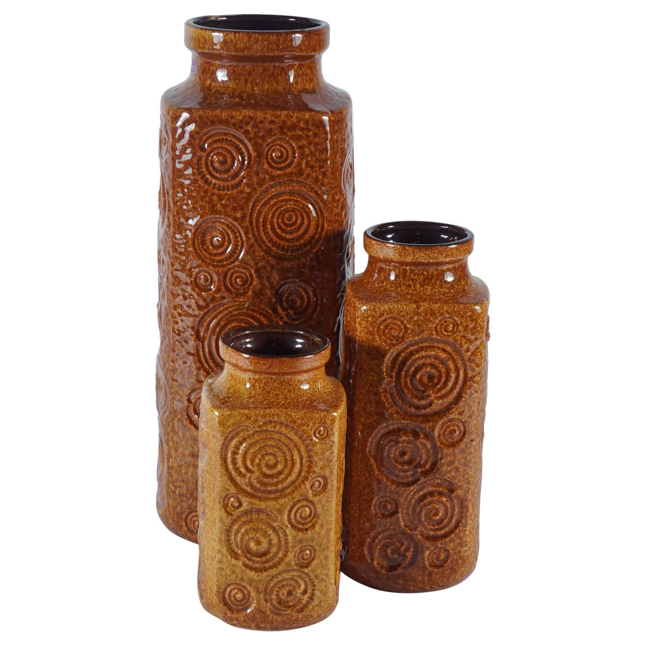 A trio of amber glazed mcm west german pottery vases at 1stdibs a trio of amber glazed mcm west german pottery vases for sale reviewsmspy