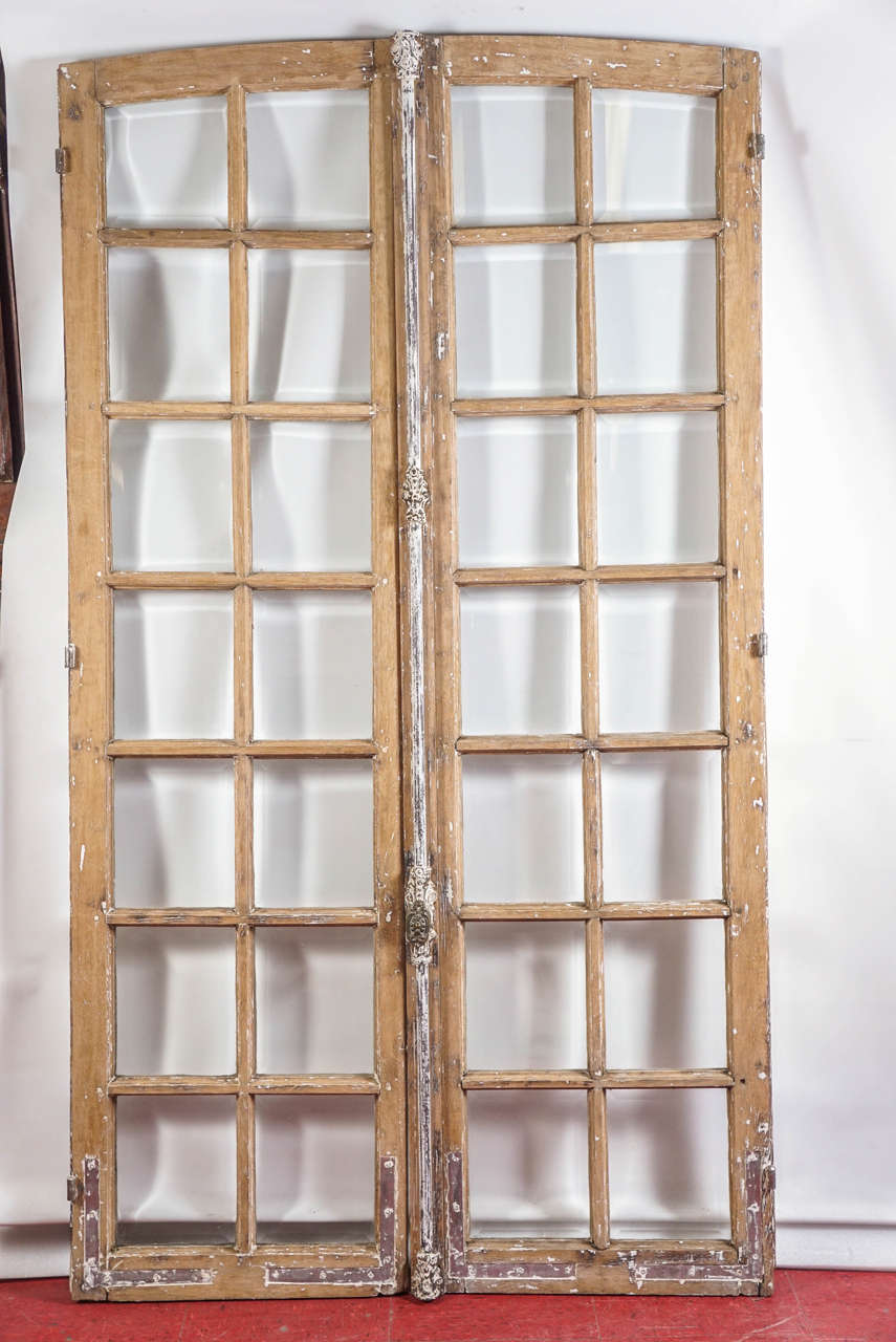 These antique double doors from France with rounded tops have bevelled  glass, original cremone bar - Antique French Doors With Cremone Bolt Lock At 1stdibs
