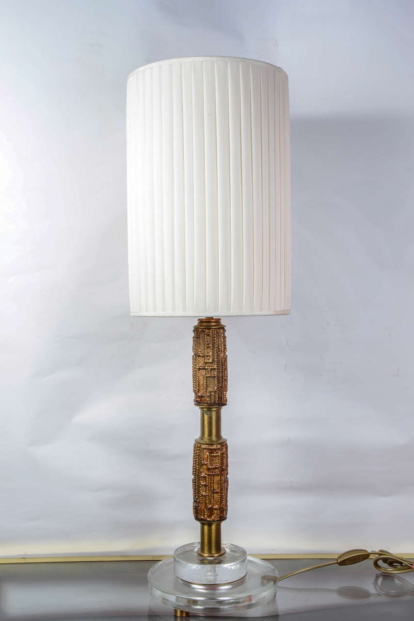 Pair of lamps designed by Luciano Frigerio. Glass and solid bronze. No shade provided. Dimensions given without shade.