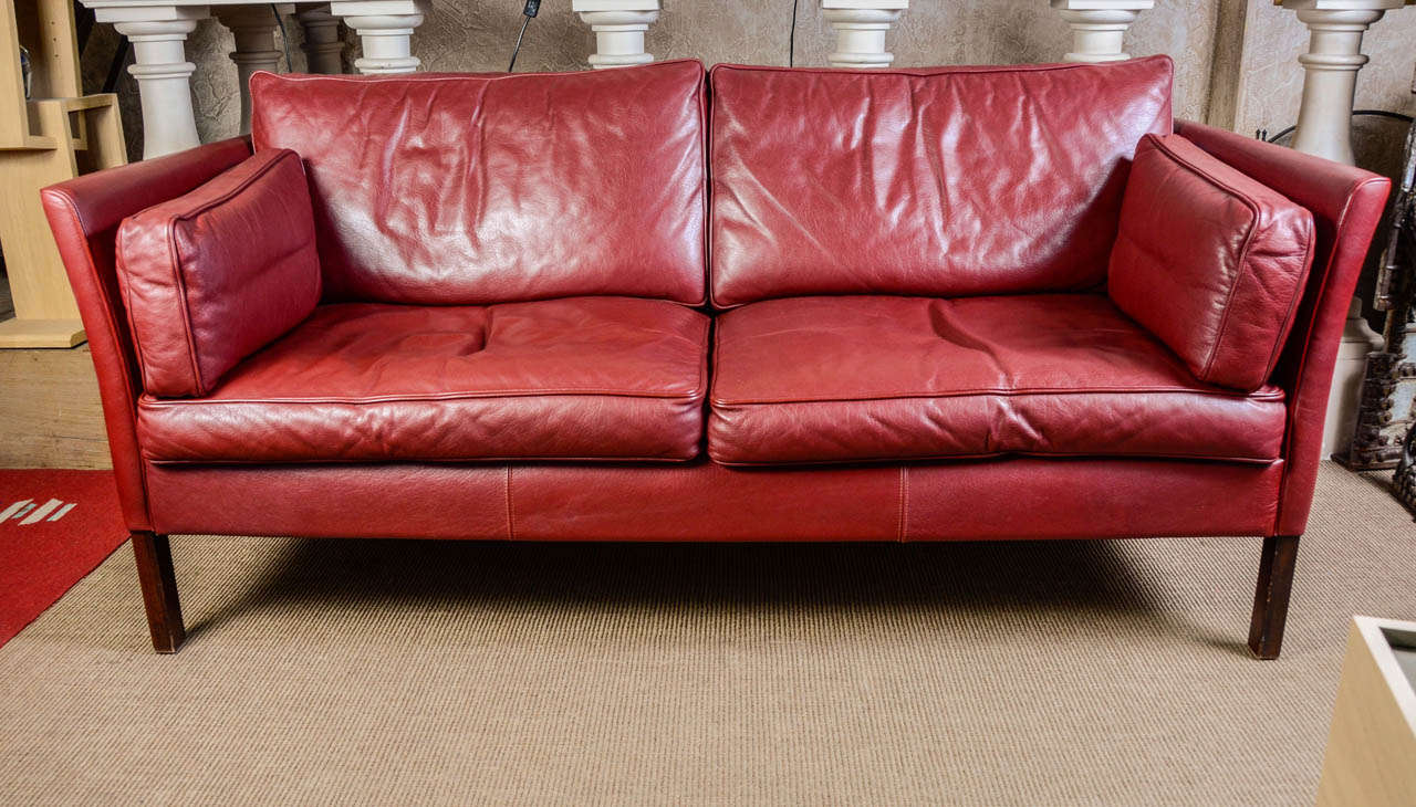 dark red leather danish sofa designed by mogens hansen at