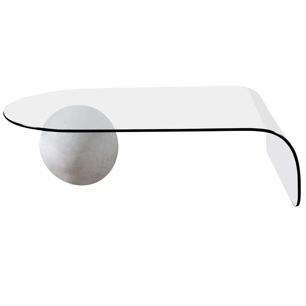 A Glass Coffee Table with a Plaster Ball