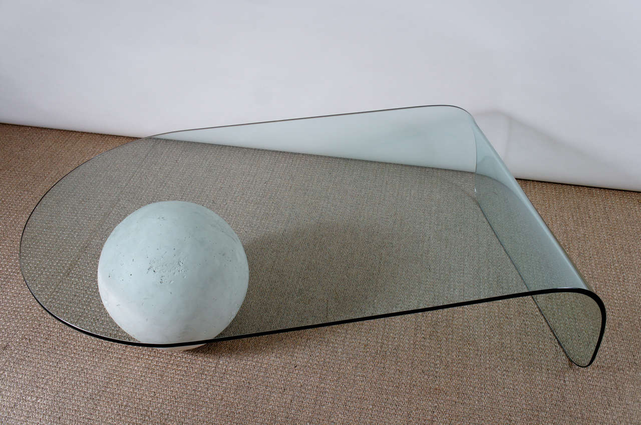 A Glass Coffee Table with a Plaster Ball 3