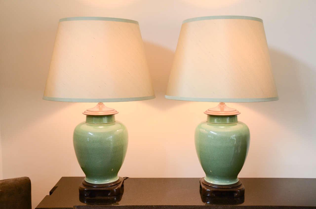 This Beautiful Pair Of Jade Color Ginger Jar Lamps Are Mounted On Wooden Asian Style Bases