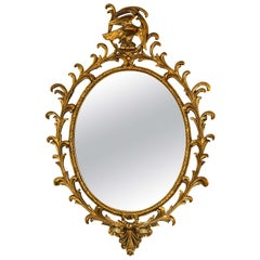 Georgian Style Gilt Exquisitely Carved Oval Mirror Adorning a Winged Eagle