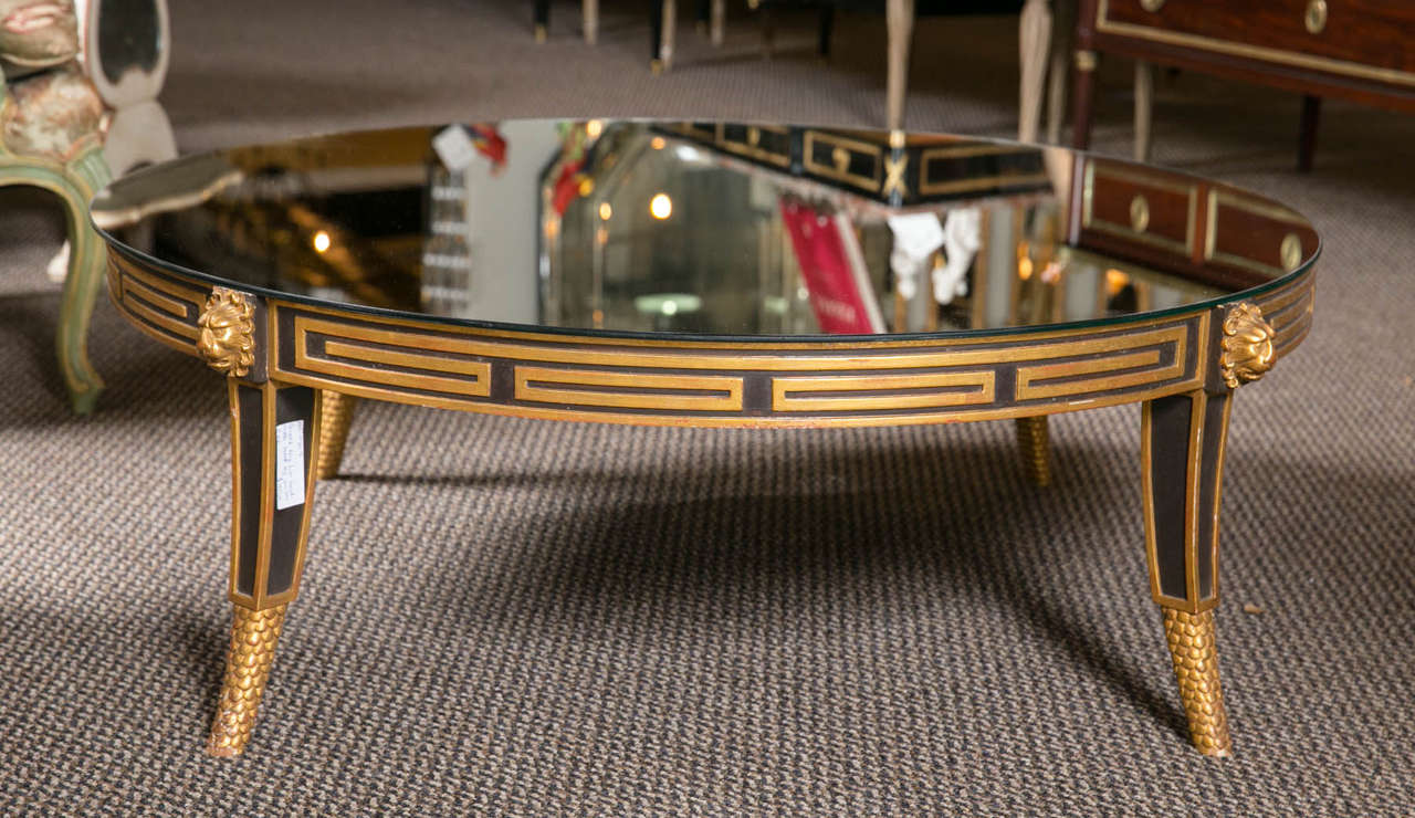 A Hollywood Regency Style Greek Key Circular Coffee Table Having Lion Heads The Recent Mirror