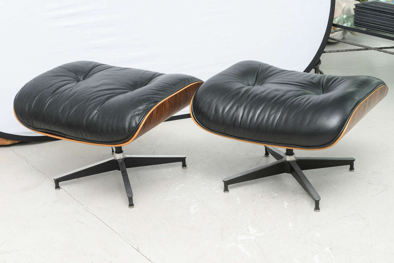 Two Vintage Eames Rosewood And Black Leather Lounge Chairs