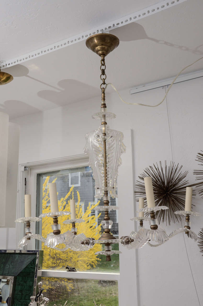Sculptural feather design 6-arm Lucite chandelier, newly rewired takes 6 candlestick style bulbs up to 60 watts. Chain and canopy included.