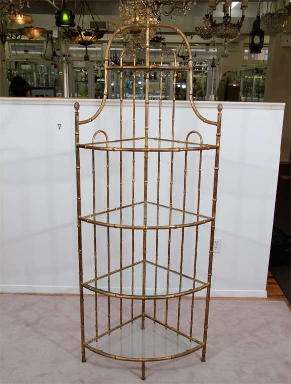 A Mid Century Etagere In Bamboo Form Gilt Metal. The Piece Has Four Inset  Glass