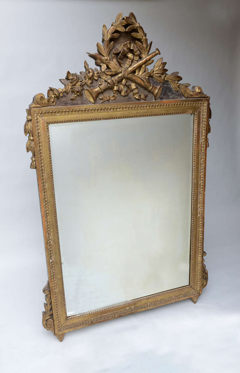 Beautifully carved and gilded neoclassical French mirror.