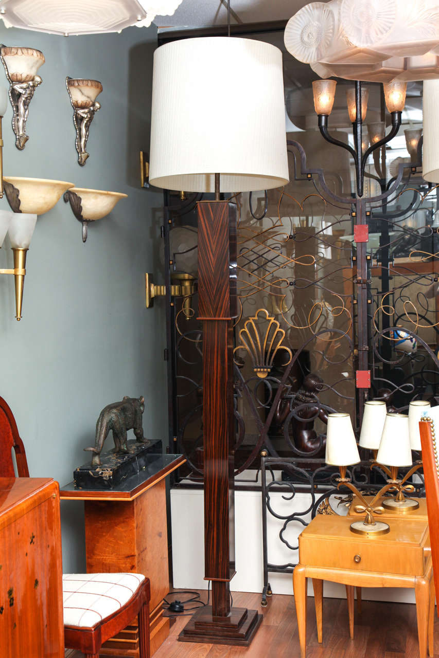 An impressive pair of French Macassar ebony veneer floor lamps, 1940s.