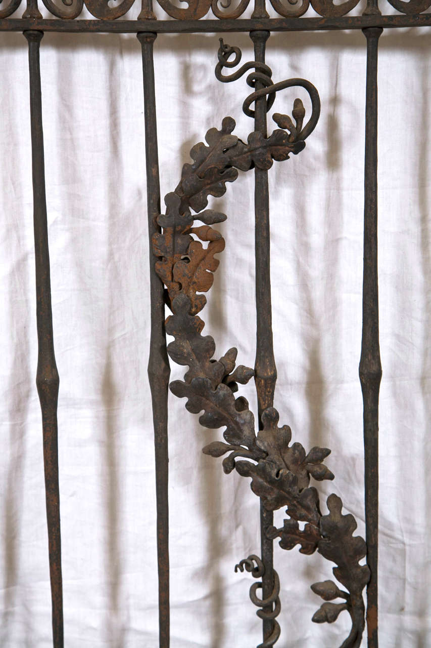 These large antique wrought iron gates and panels are gorgeous and would be perfect for an entrance way, garden or a calm and serene sitting / resting place.  The ornate detail is done in an acorn,vine and leaf pattern with twisted roping.  These