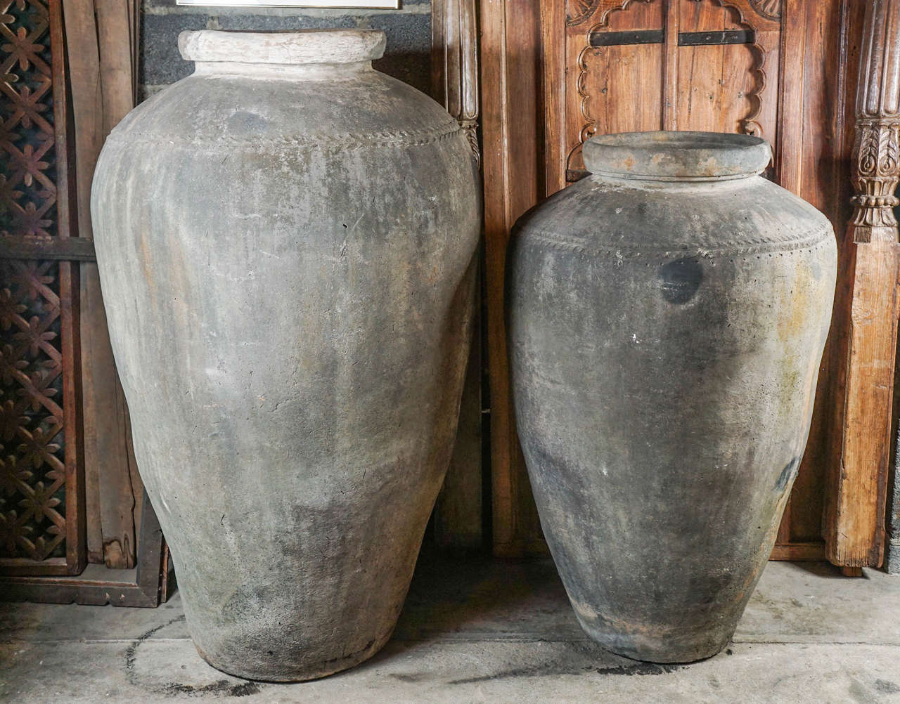 """Monumental clay pots from Northern India, can be used as a garden sculptures. Size: Large: 61 """"H X39 """" Diameter Price: $2500  Small: 51""""H X32"""" Diameter Price: $2200."""