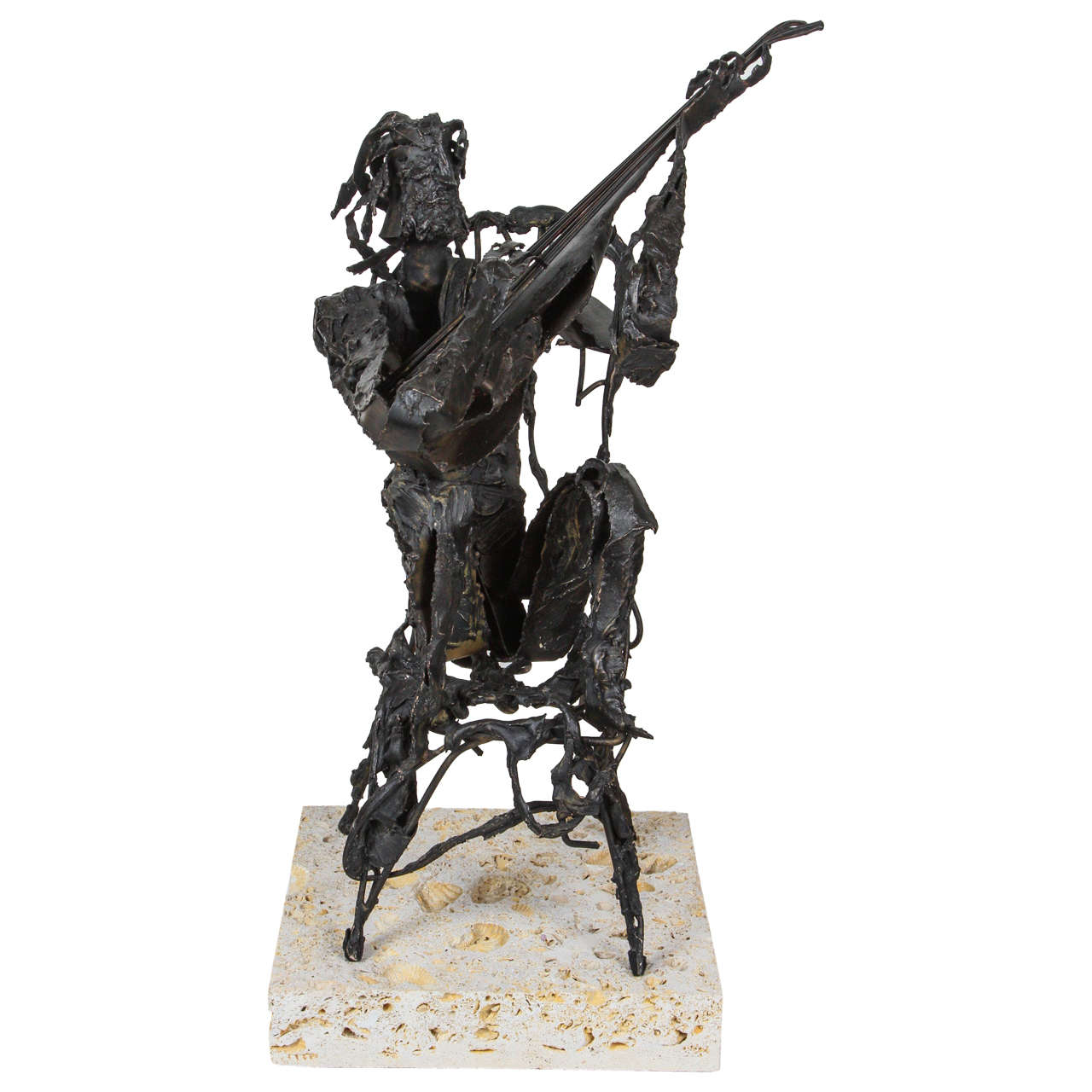 Metal Sculpture of Man Playing Guitar