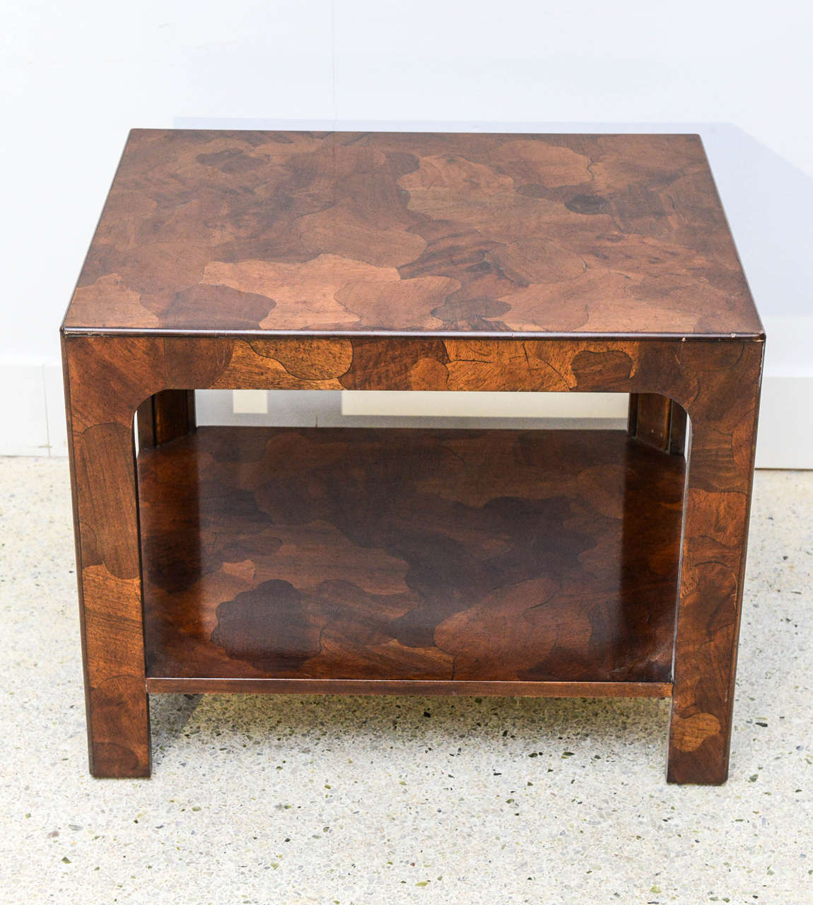 The exotically inlaid mixed wood veneers with square legs and a shelf, can be sold separately or together with companion octagonal table.