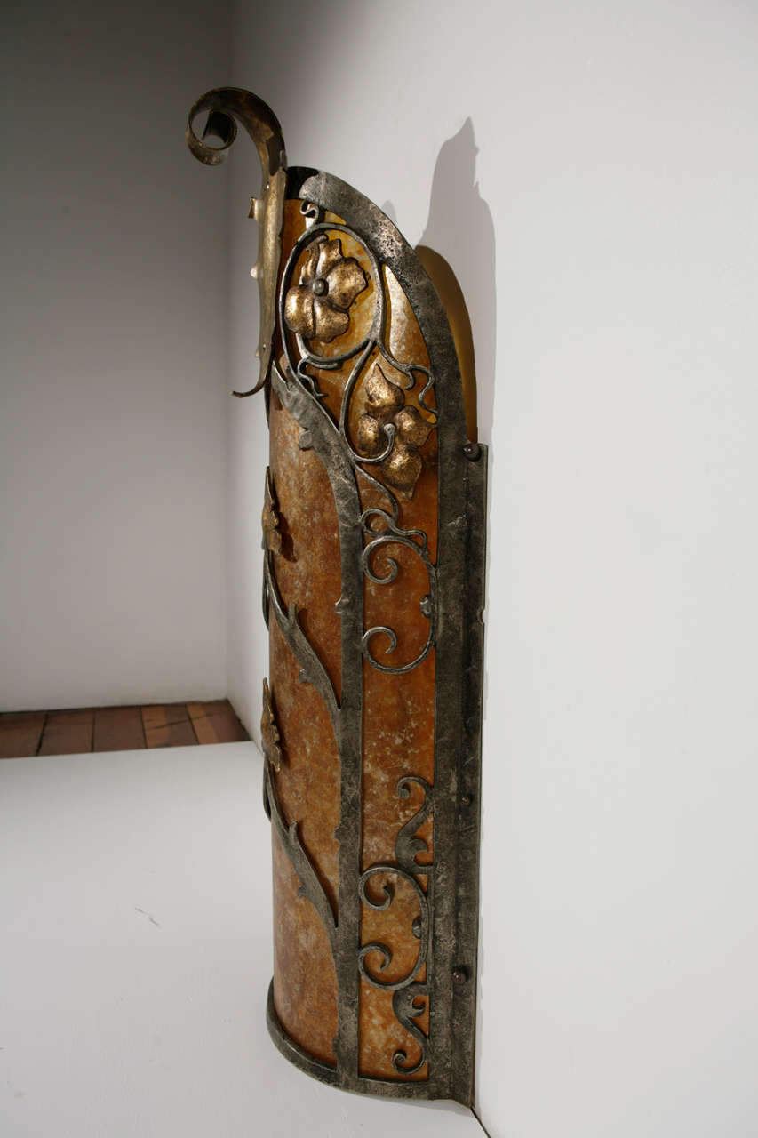 Cast brass exterior sconce with mica.