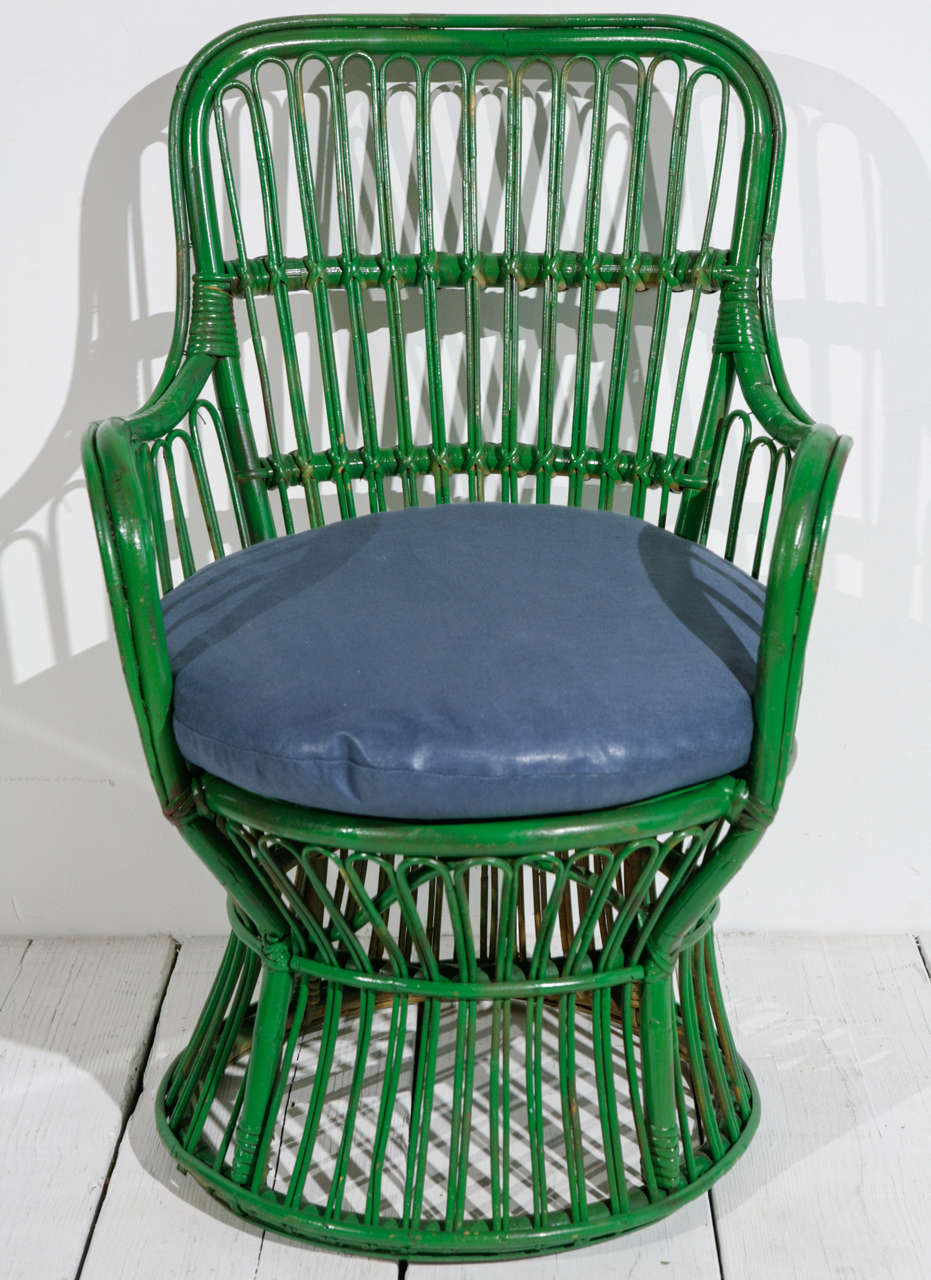 Italian style Kelly green painted wicker armchair with newly upholstered blue round cushion.