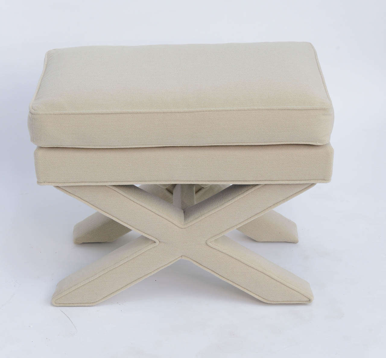 Sleek and urbane, this Billy Baldwin style bench in Classic X-form has a plush double tier seat. Newly upholstered in an off white vintage Knoll bouclé short loop fabric. A singular sensation! Measures:  26 inches  x  16 1/2 inches  x  20 inches
