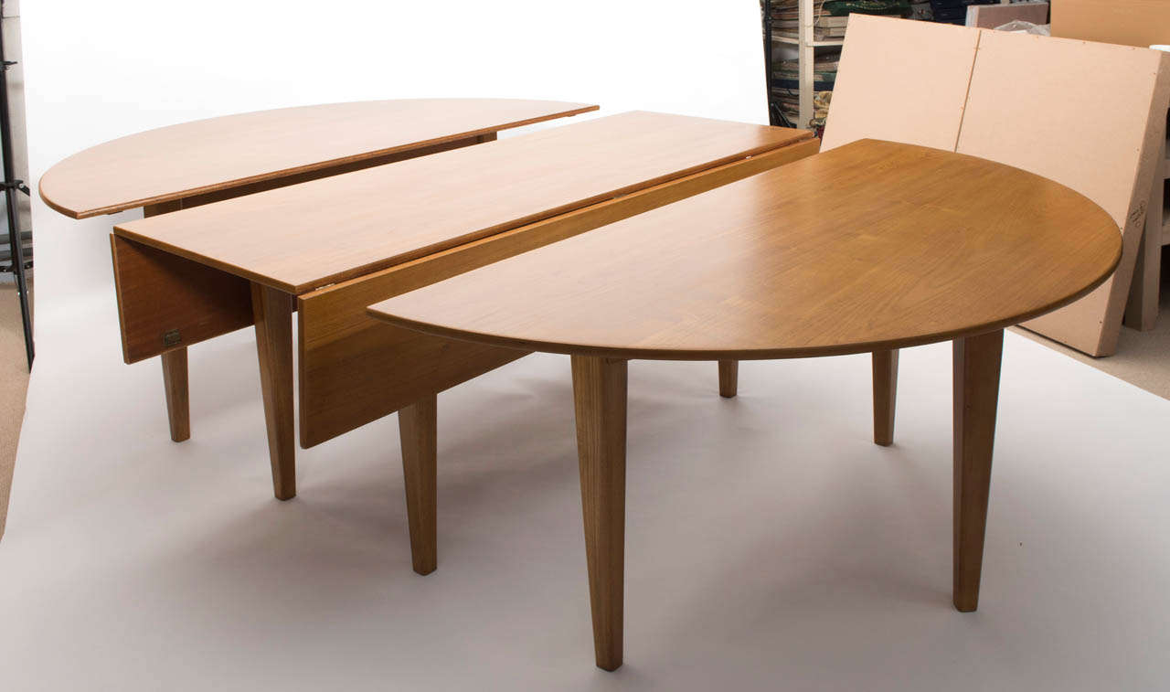 Large Extending Teak Dining Table by Heals of London at  : 019 from www.1stdibs.com size 1280 x 757 jpeg 56kB