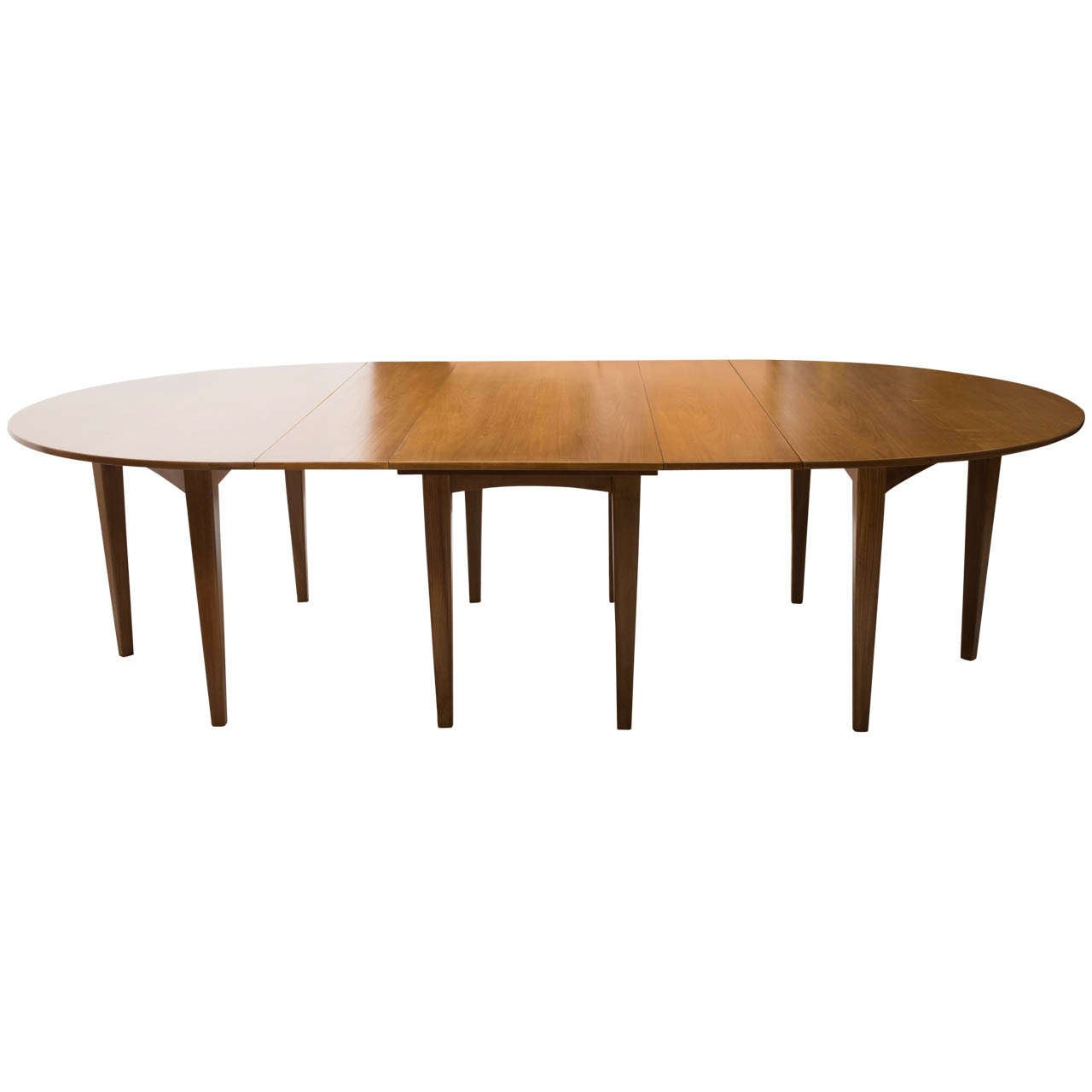 Large extending teak dining table by heals of london at for Dining room tables london