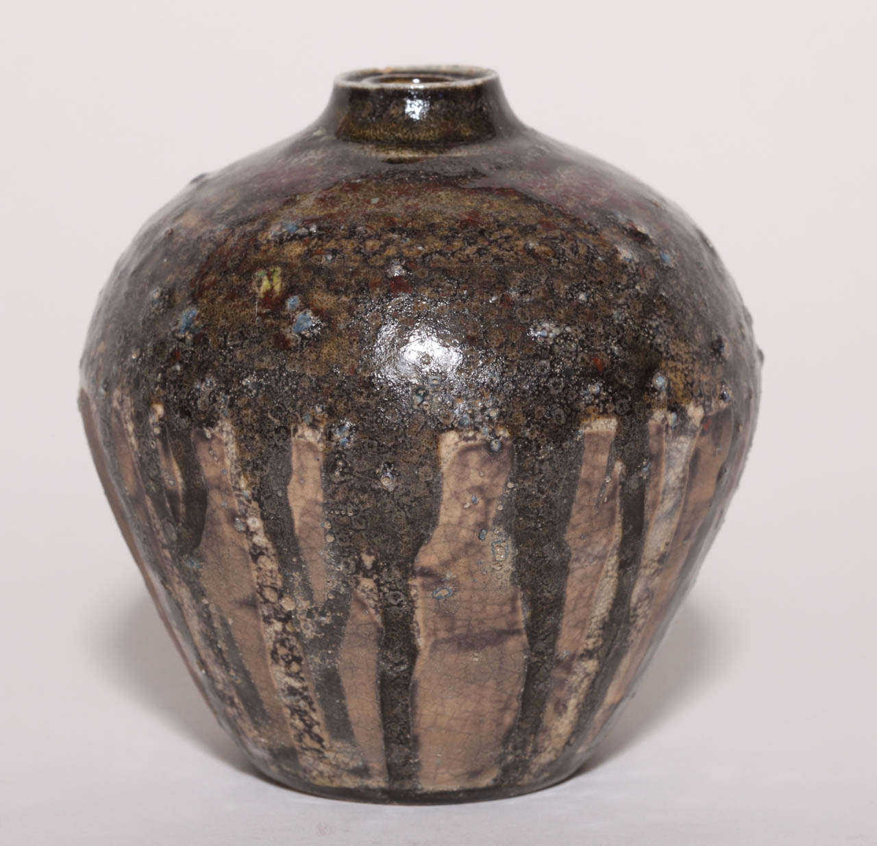 Multi-colors on large neck tapering to small base with linear decoration of brown glaze on lower part of vase. Signed: H Sim in enamel.  Variety of other Henri Simmen pieces available.  (Price shown is reduced price, no further trade discount)