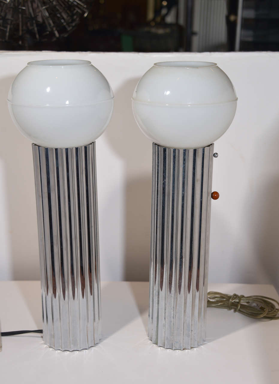 Machine Age Art Deco pair Signed Von Nessen, Nessen Studio fluted chrome table lamps price reduced  USA, c. 1930 Chrome-plated brass, glass, Bakelite/Catalin knobs Iconic early Nessen fluted design  Signed with impressed manufacturer's mark to