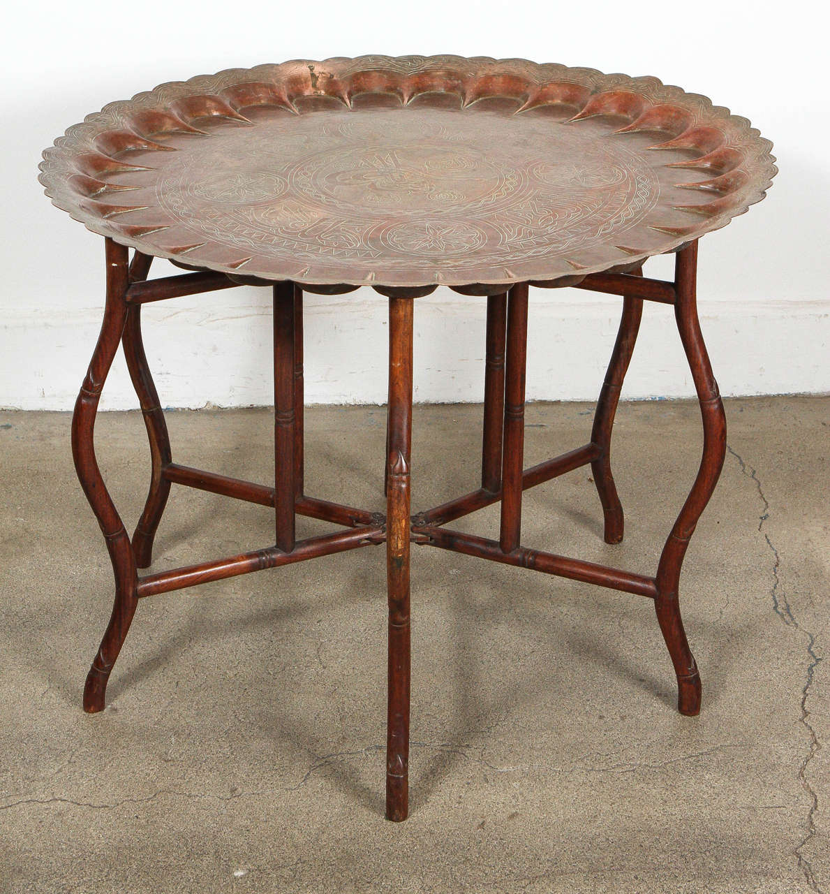 Very hard to find large scaleTurkish copper tray table on bamboo folding base, could be use as a coffee table or game table, this is how they use them in Morocco, Syria, India, Egypt and in the Middle East to serve food or tea or play. Great for