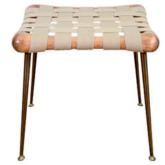 A Square T.H. Robsjohn-Gibbings Webbed Stool with Long Brass Legs.