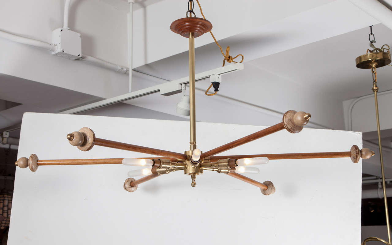 Wood and brass sputnik light fixture with six lights and six decorative arms.  USA, circa 1970.  Wired for U.S.; takes six chandelier base bulbs, 60 watts max each.