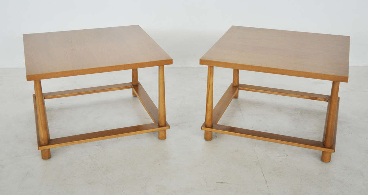 Pair of end tables by T.H. Robsjohn-Gibbings.