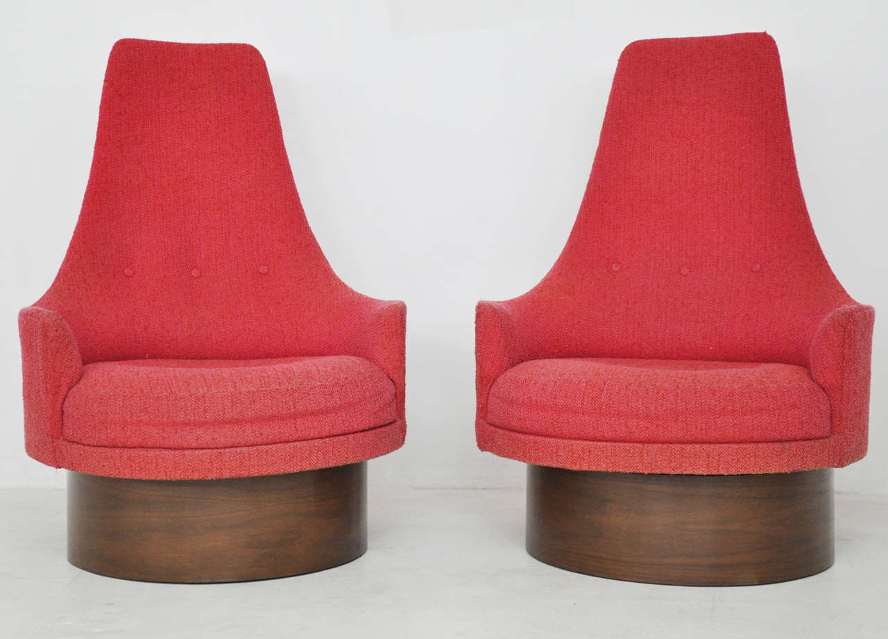 High back swivel chairs by Adrian Pearsall. Refinished walnut bases.