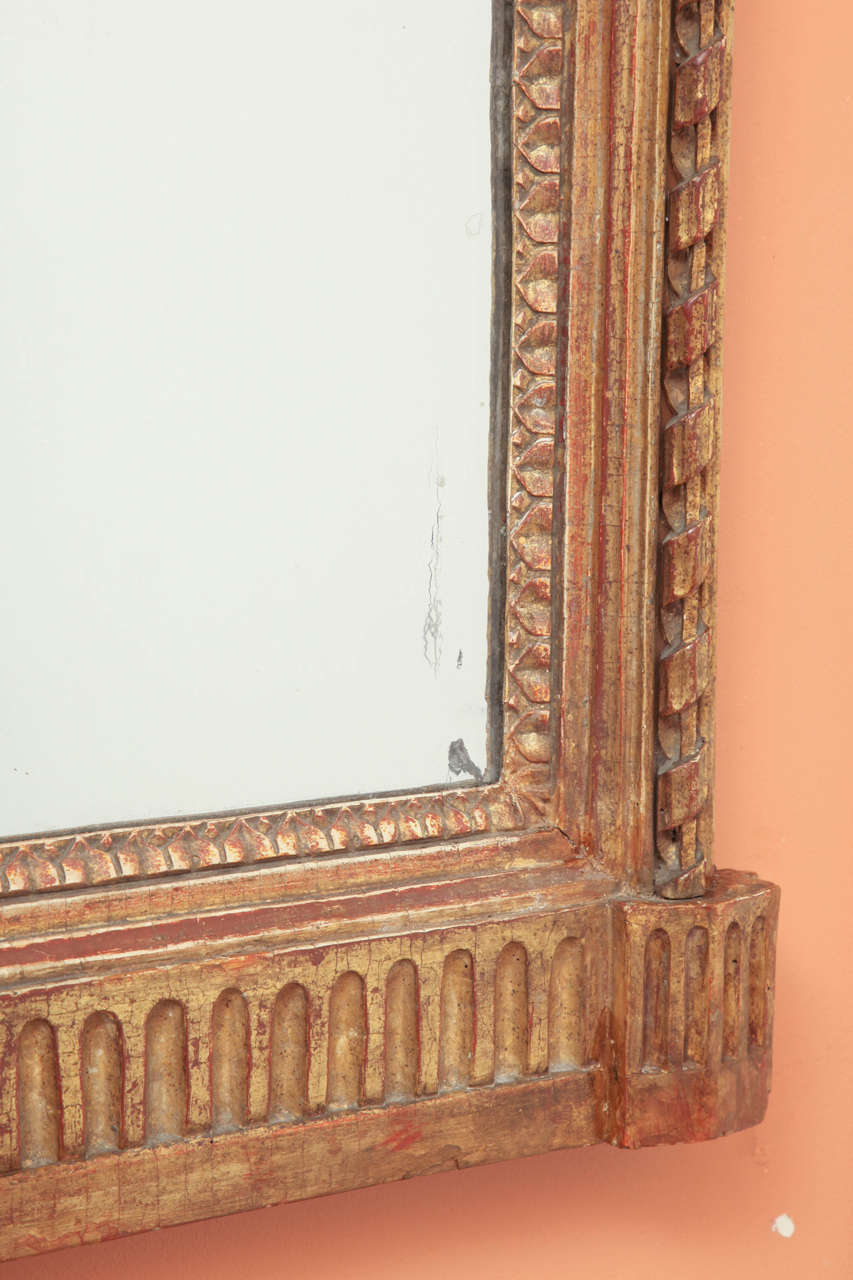 French Louis XVI Console Mirror with Urn and Foliate Swagged Crest For Sale