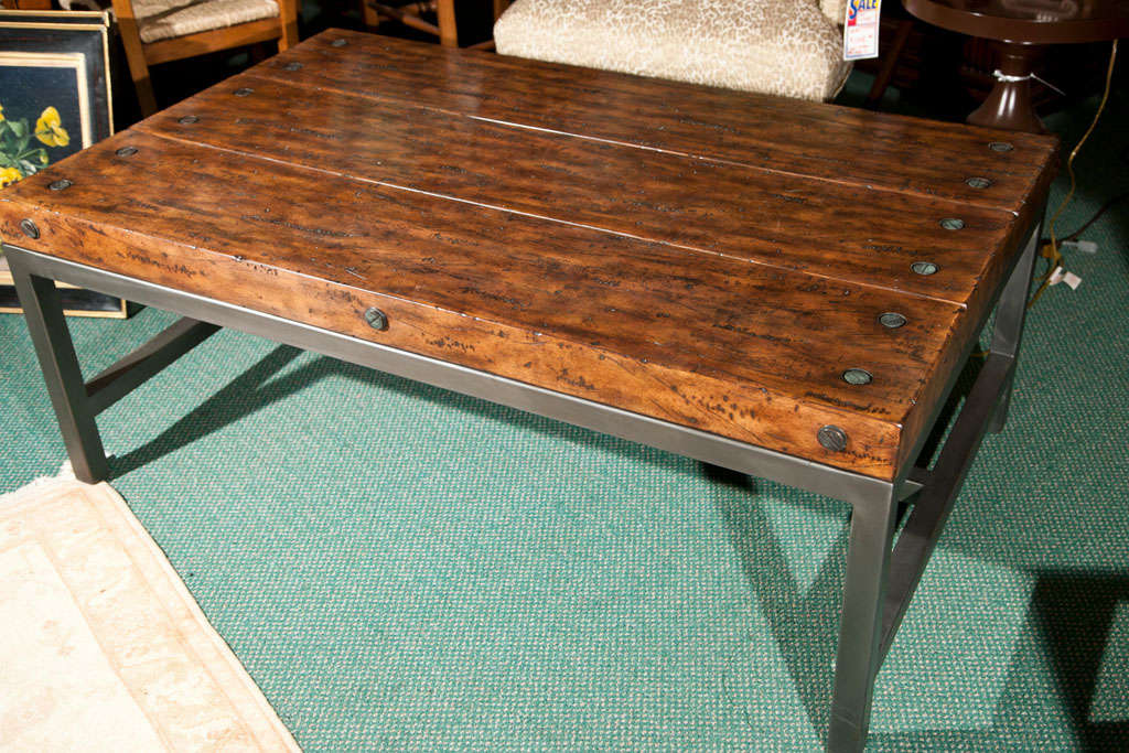 Wood plank cocktail table on gunmetal metal base at 1stdibs for Wood plank top coffee table