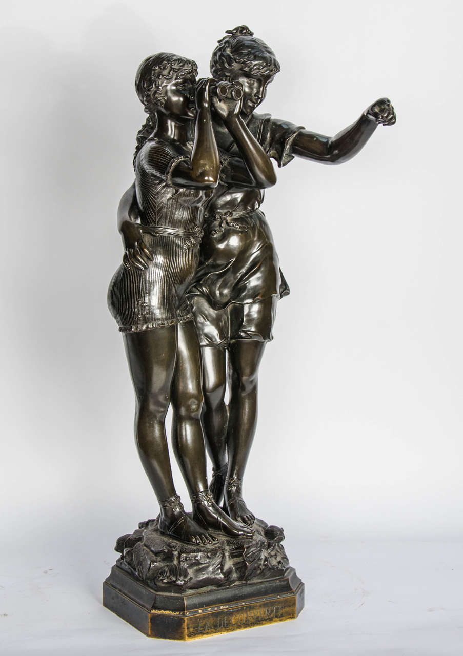 An enchanting bronze study of two young girls looking through binoculars. Entitled 'La Decouverte (discovery) Signed Ferrille Juan.
