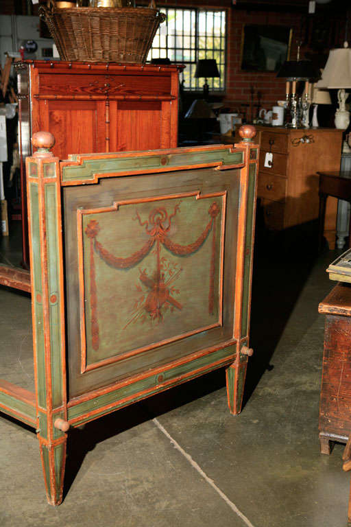 This unusual and interesting bed frame is thought to be Italian, mid 19th century, and has an abundance of hand painted classical decorative elements. Used as a bed or a day bed it will be a hit and provide inspiration in your next setting.
