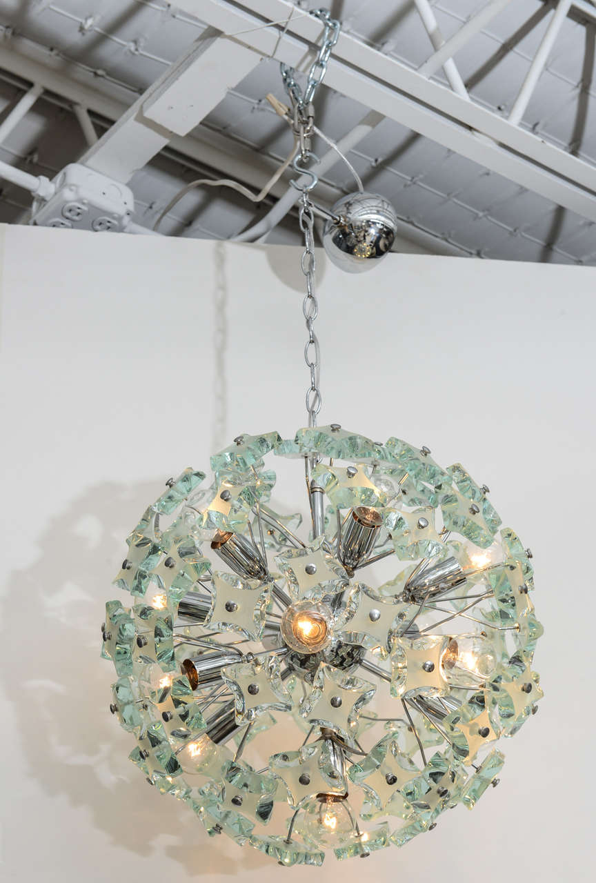 We're enchanted by this dandelion-style 60's Italian sputnik chandelier. The 13-light, chrome frame holds gorgeous green glass pieces, etched and hand-faceted in the manner of Max Ingrand.