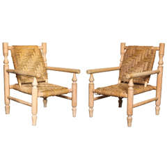 Pair of 1950s French Armchairs in the style of Charlotte Perriand