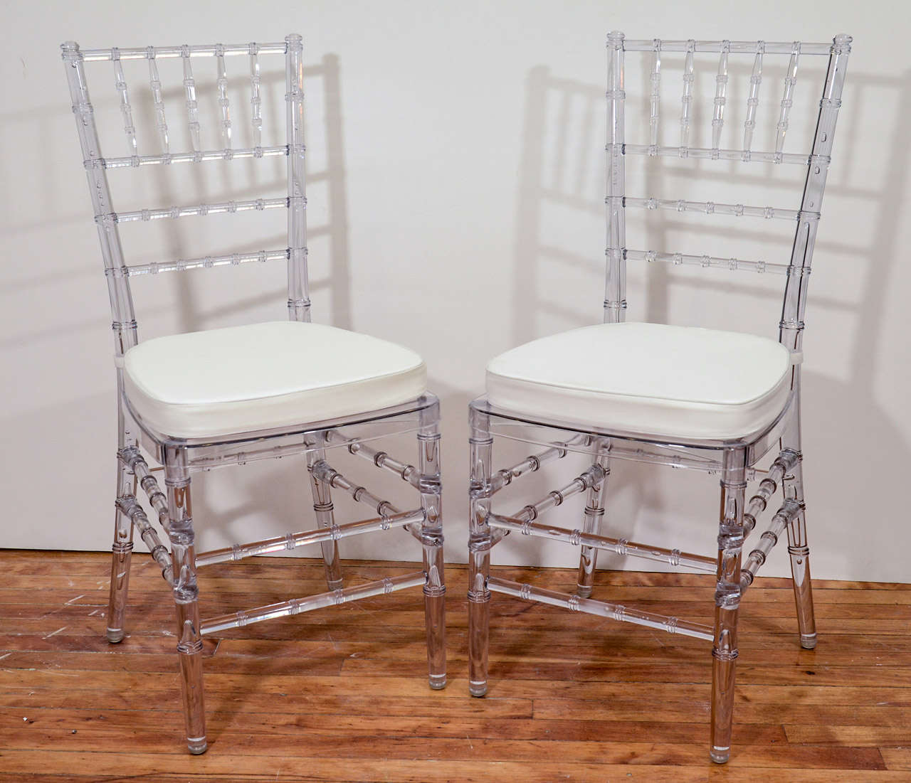 A Vintage Set Of Eight Dining Chairs With Faux Bamboo Clear Acrylic Frames And White