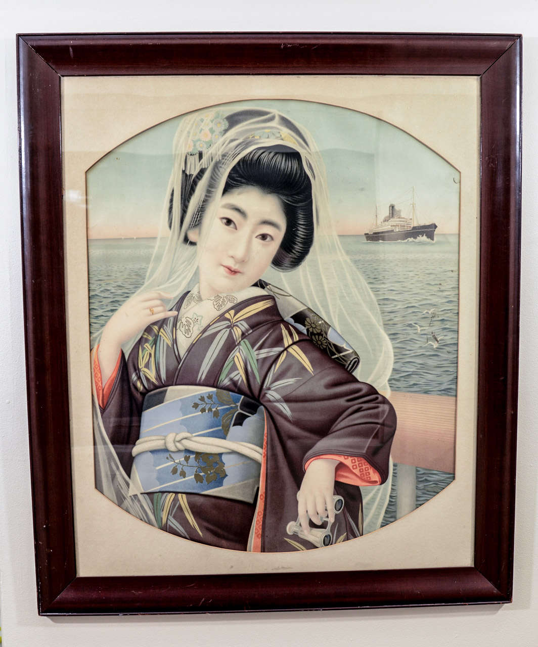 A Japanese late Meiji period portrait of a young lady standing near the ocean.